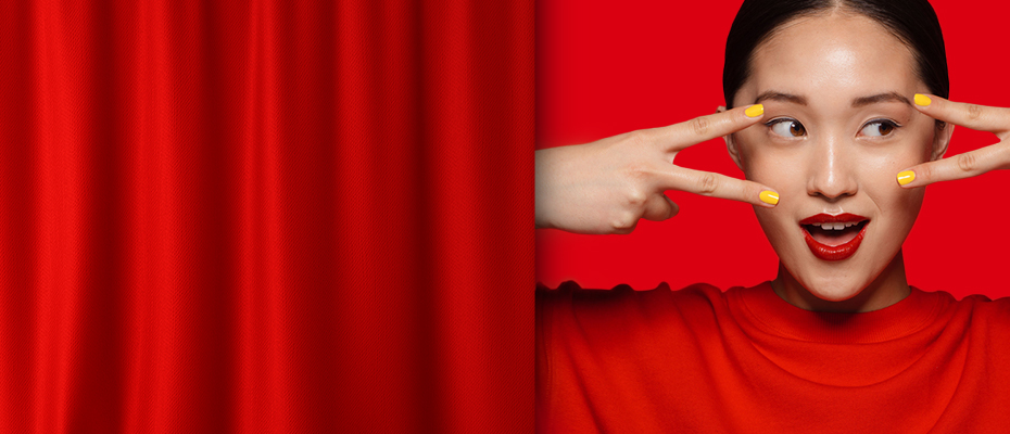 A girl with red cloth in red background; image used for HSBC Taiwan homepage.