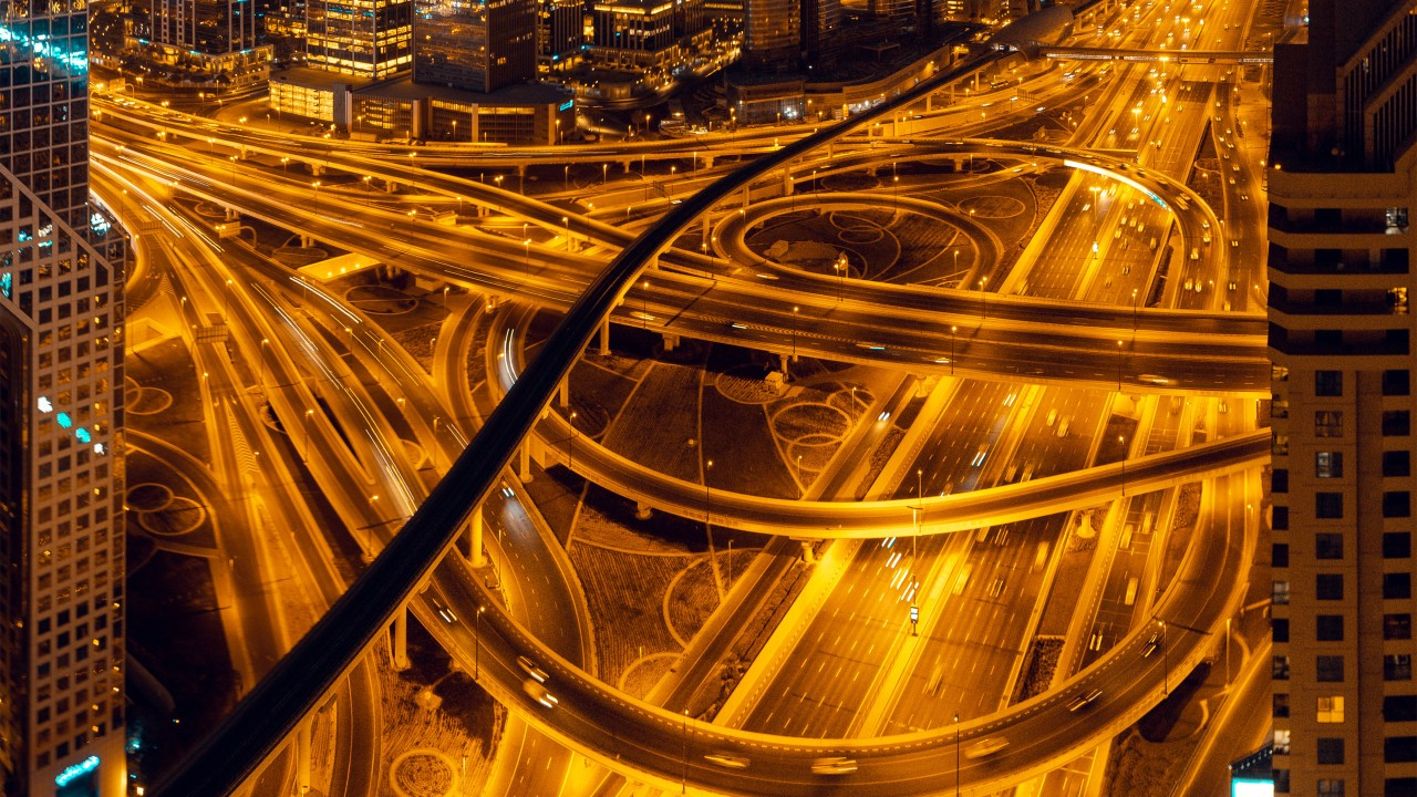 A night view of a busy traffic interchange; imaged used for HSBC Taiwan foreign exchange page.