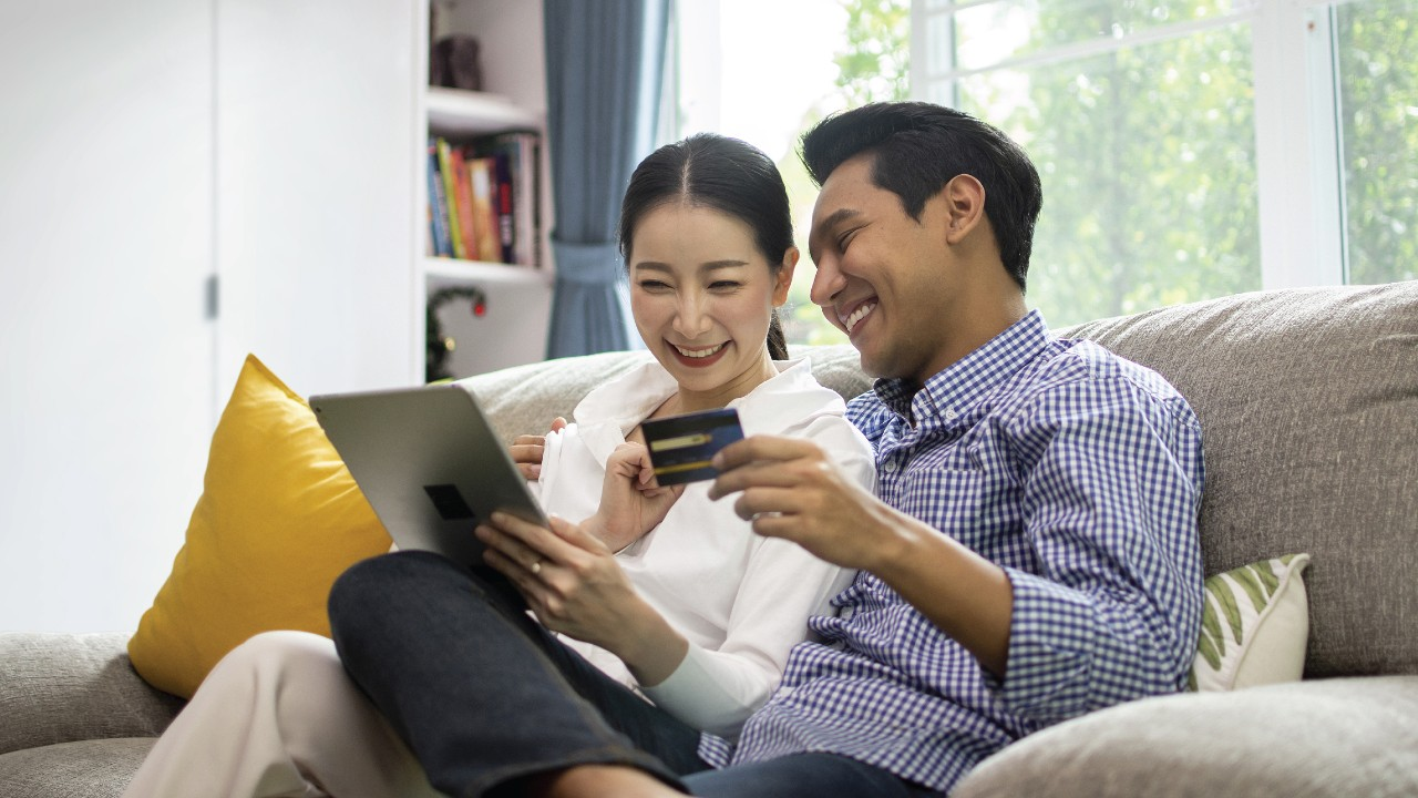 Couple watching tablet on sofa;image used for HSBC Security Centre page.