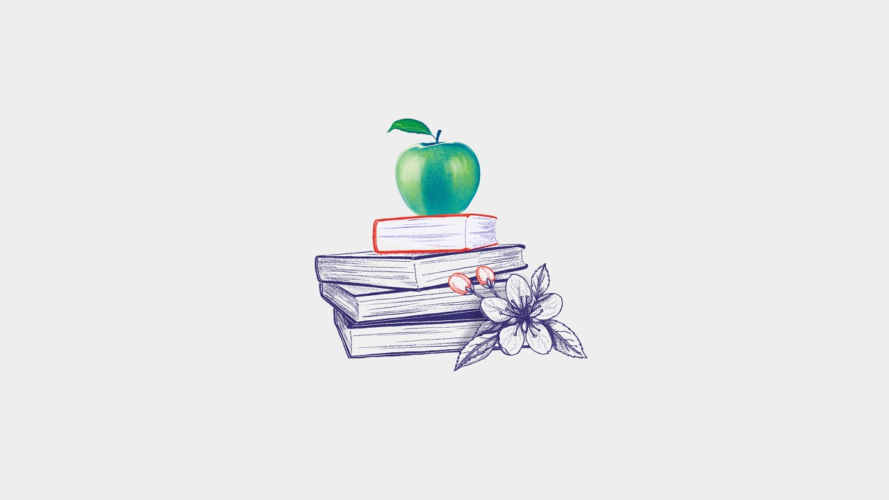 A green apple was placed on a stack of books; image used for HSBC overseas education.